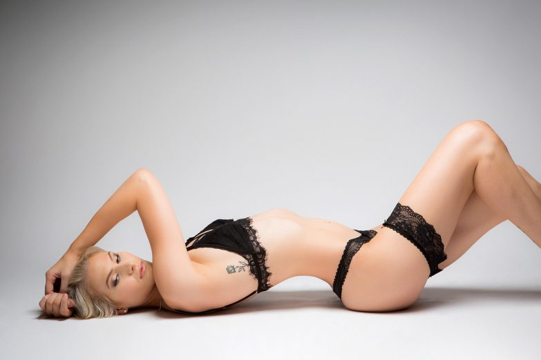 Blonde Perth woman in black lingerie.