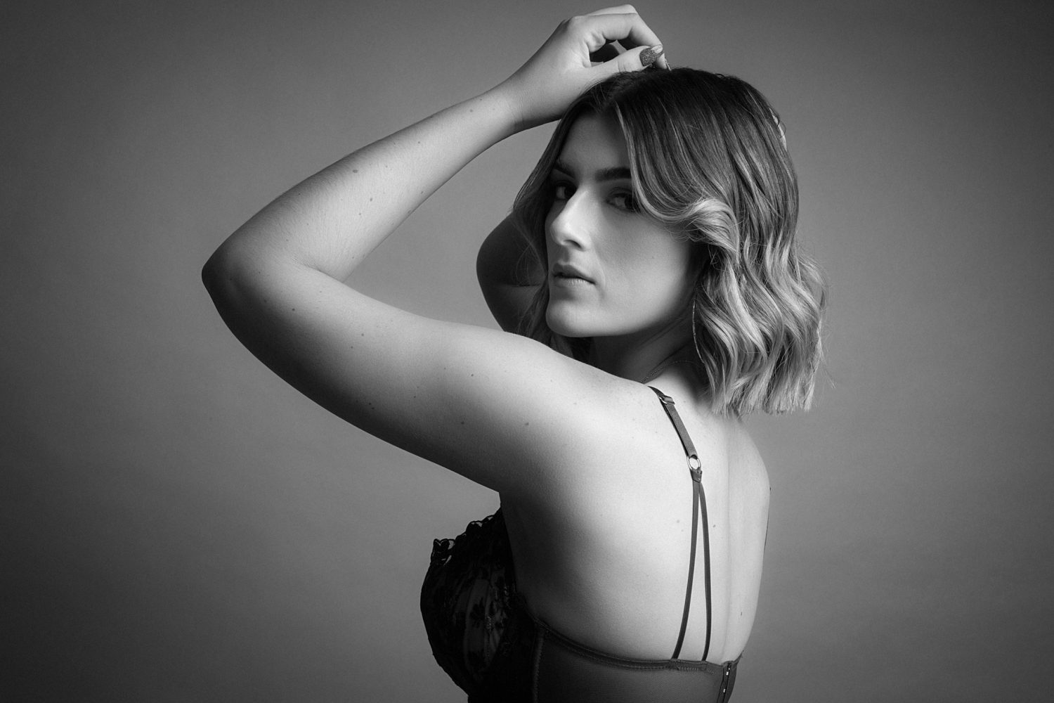 Beautiful woman in artistic black and white boudoir shoot with Perth photographers Cooper Studio