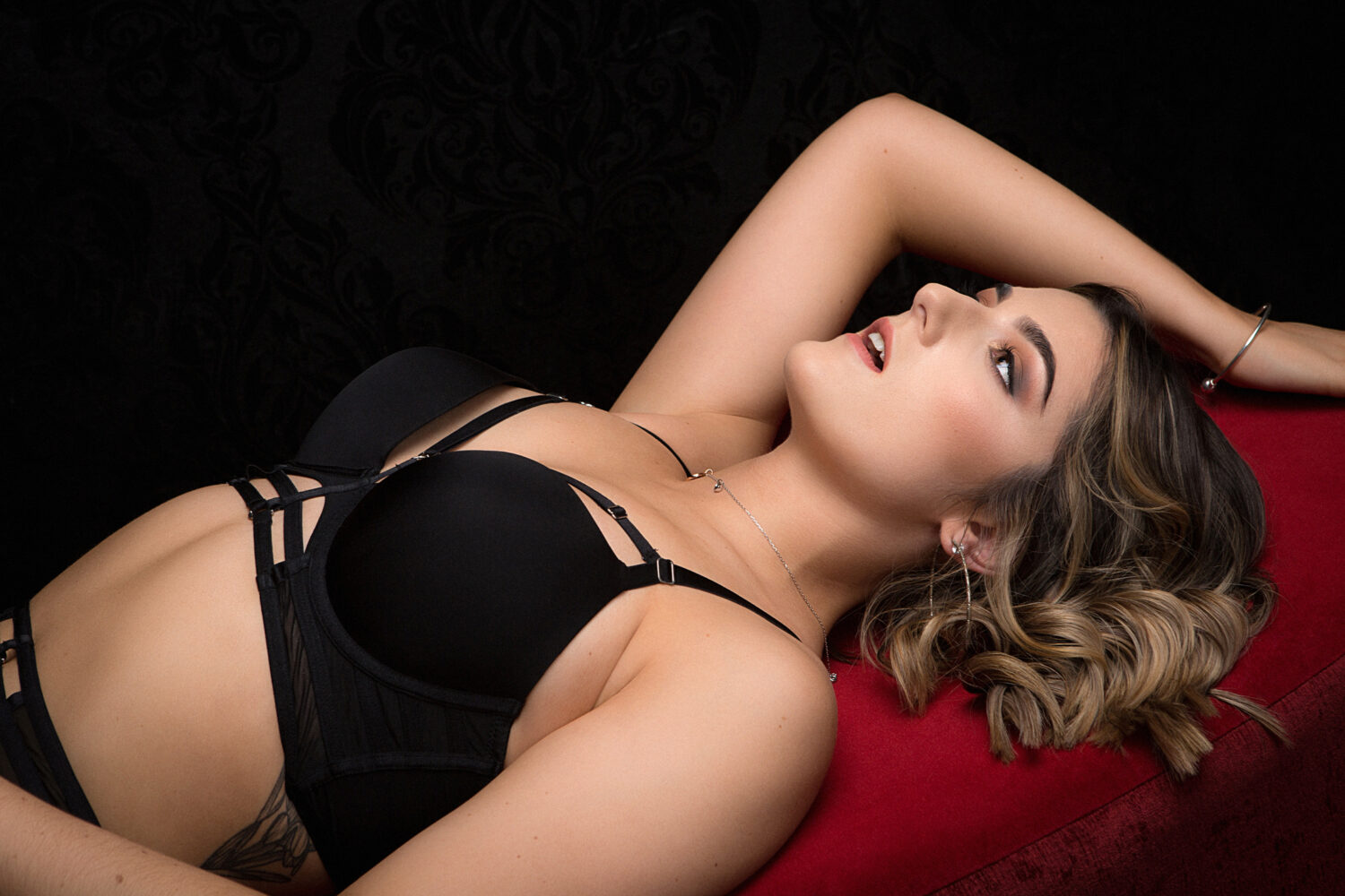 Tasteful boudoir photograph of woman reclining by photographers in Perth, Western Australia