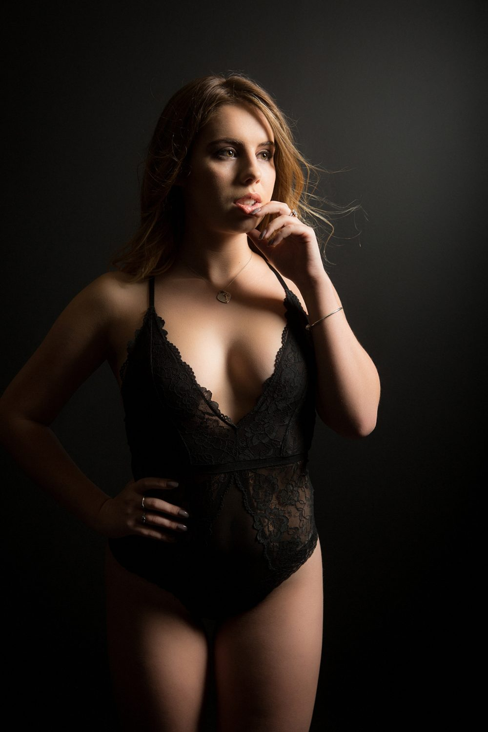 woman in lingerie poses for a boudoir photo shoot in a Perth studio