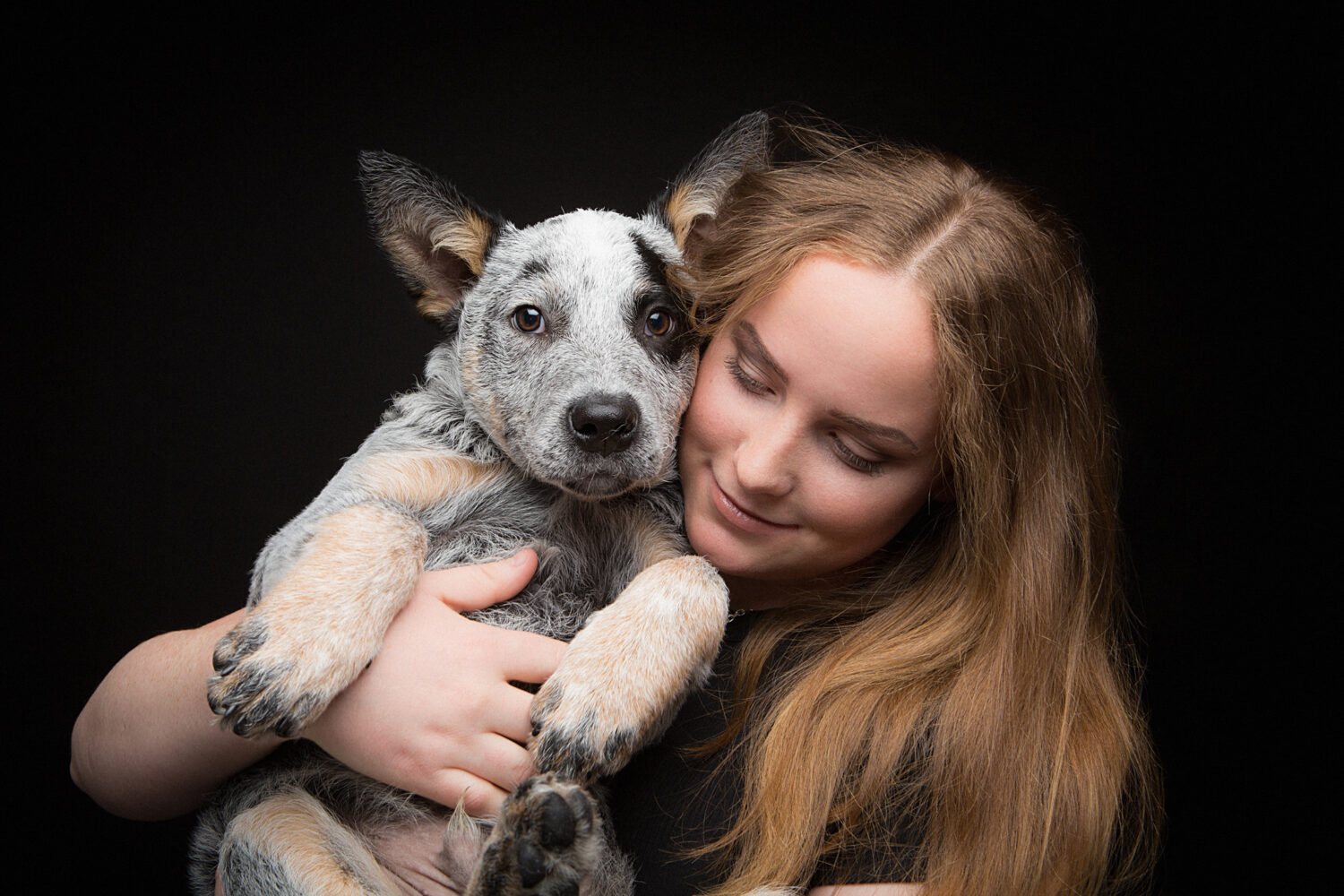 Young woman with blue heeler puppy | pet photography